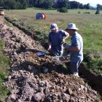 John and Peter backfilling the trench George dug